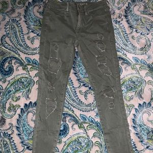 Army green colored ripped jeans